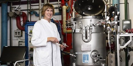 Associate Professor, Anna Lantz next to a 150 litre pilot plant fermentor. Photo: Thorkild Christensen.